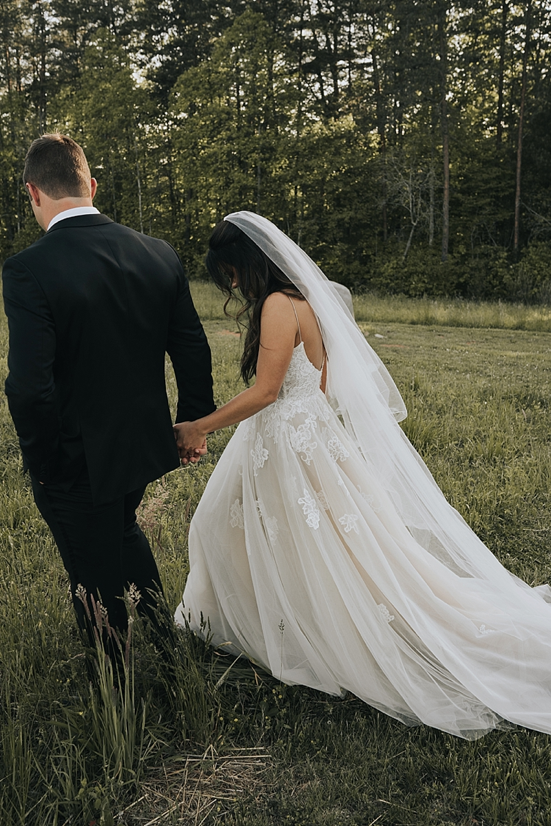 bride in monique lhuillier wedding dress